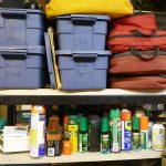Bug spray, bear spray, first aid kits, and straps.
